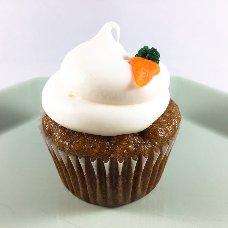carrot cupcake with white frosting