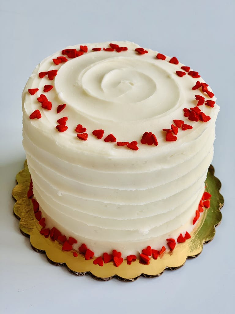 a large white cake sitting on top of a table
