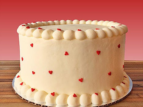 white cake with hearts