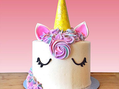 Vanilla or Chocolate cake layered with vanilla bean buttercream , topped with pink hued buttercream rosettes and topped with a fondant unicorn horn