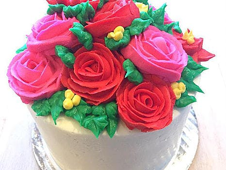white cake with flowers on top