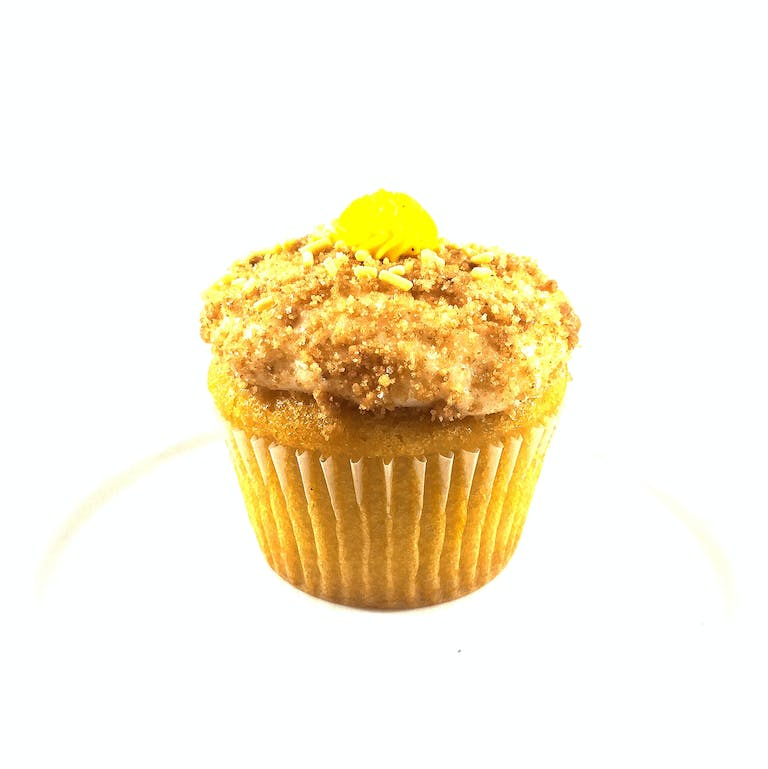 Lemon cupcakes filled with lemon curd, topped with cream cheese frosting dipped in graham cracker crumbles and a dollop of lemon buttercream