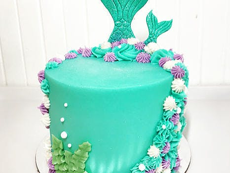 Chocolate or Vanilla cake layered with vanilla buttercream and a mermaid design with buttercream and fondant