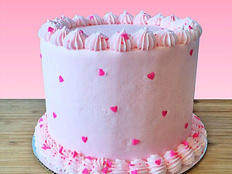 pink cake with hearts
