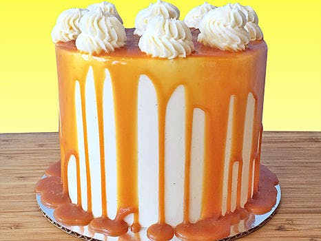 white cake with caramel dripping