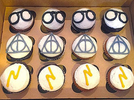 An assortment of Chocolate & Vanilla cupcakes topped with buttercream Harry Potter designs