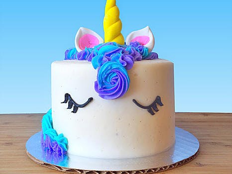 Vanilla or Chocolate cake layered with vanilla bean buttercream, topped with blue hued buttercream rosettes and topped with a fondant unicorn horn