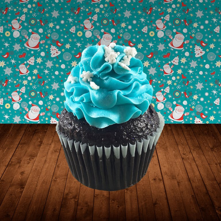 Chocolate cupcakes filled with mini chocolate chip cream cheese frosting, topped with sky blue cream cheese frosting, snowflake sprinkles and edible glitter
