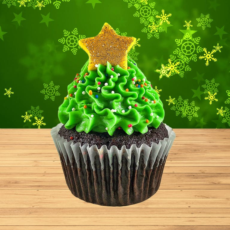 Gluten free and vegan chocolate cupcakes filled with vegan caramel, topped with vegan green frosting, rainbow nonpareil sprinkles and a shimmery gold star. Just like a Christmas tree!