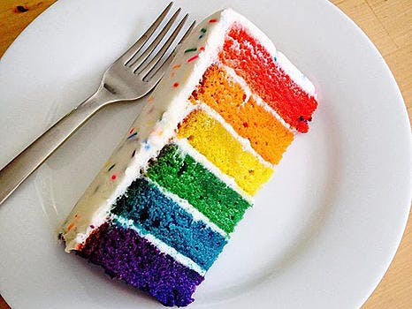 Rainbow cake with white frosting