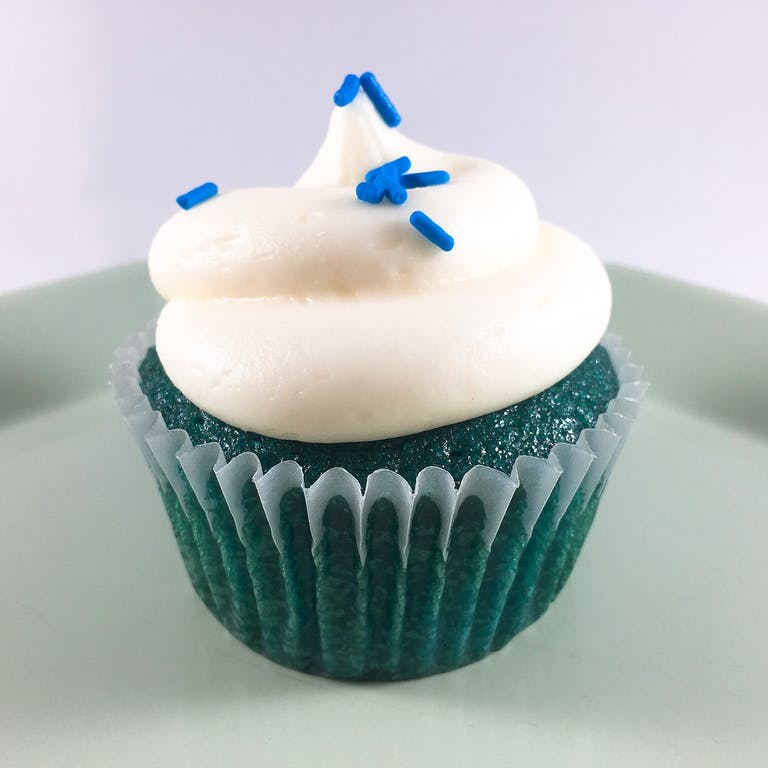 blue cupcake with white frosting