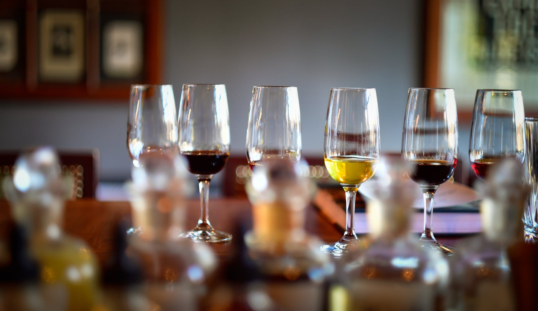 a closeup of multiple glasses of wine