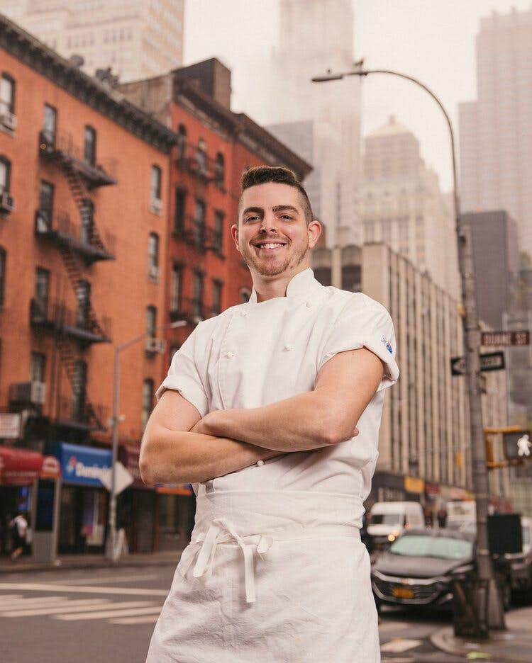 a man standing on a city street