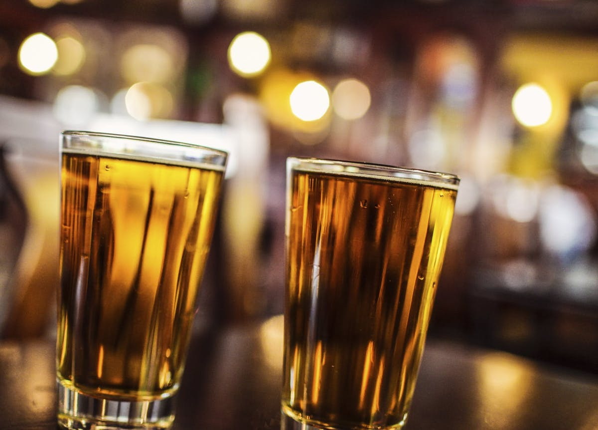 a close up of two glasses of beer