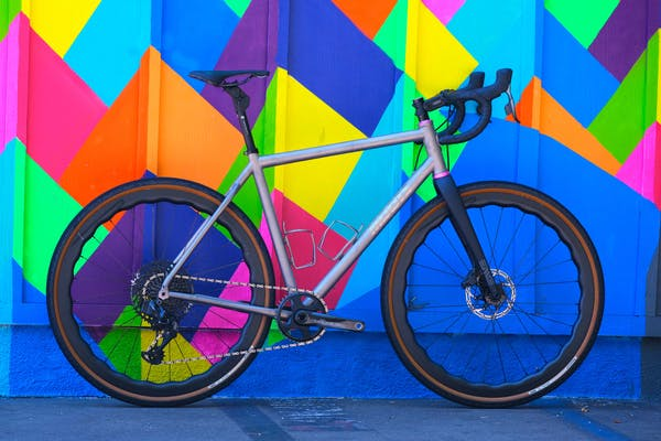 a bicycle parked in front of a colorful kite