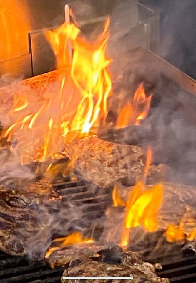 a fire on the grill