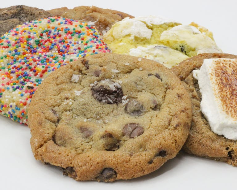 a close up of a pile of may different type of cookies