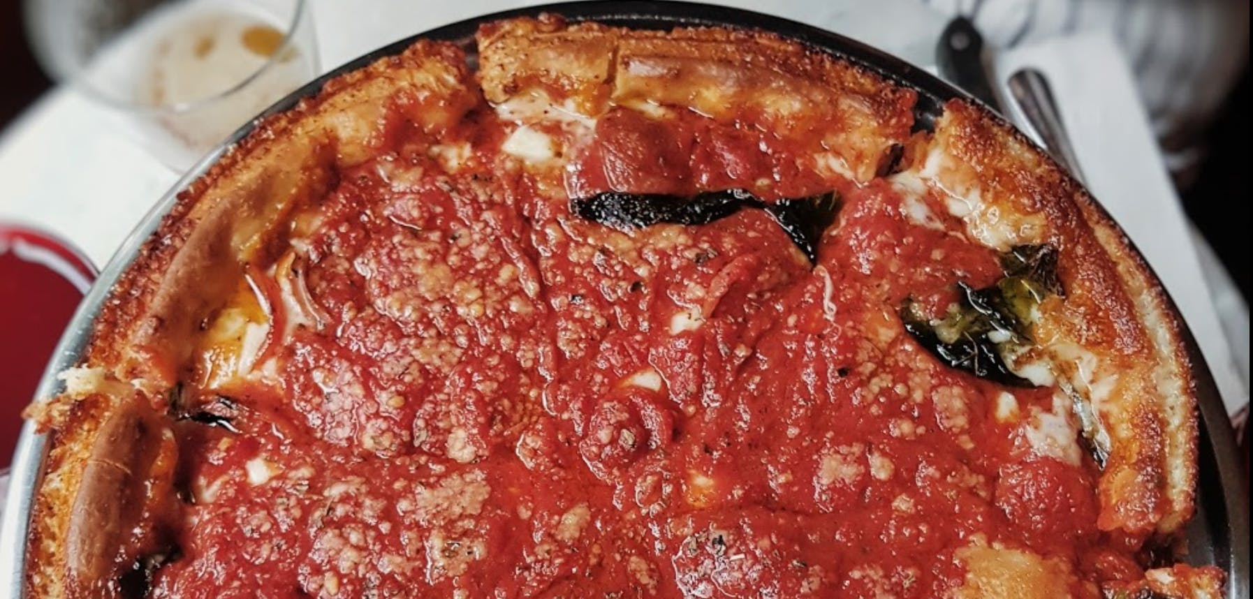 a close up of a slice of pizza on a plate