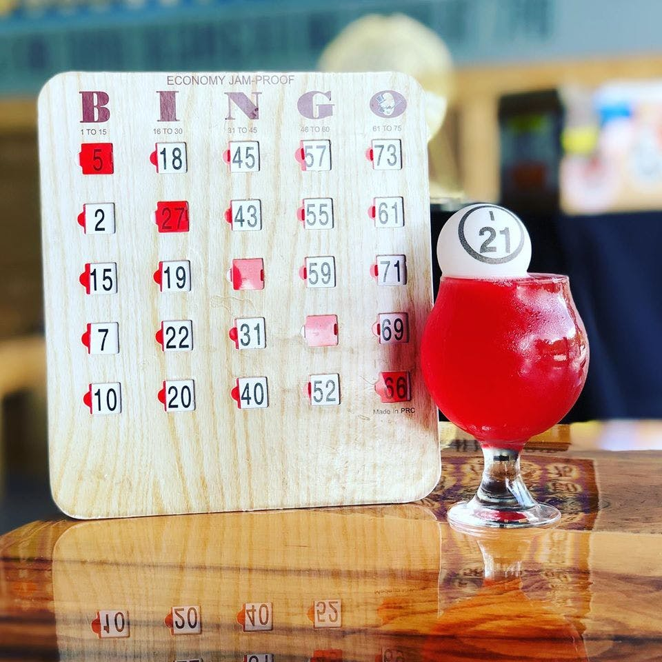 an image of a bingo board next to a beverage