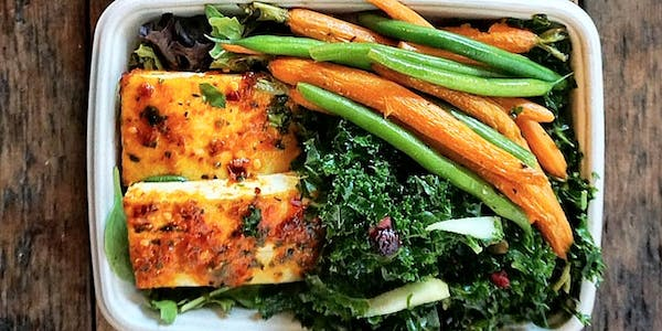 Tofu lunch special with kale apple salad and fresh seasonal carrots