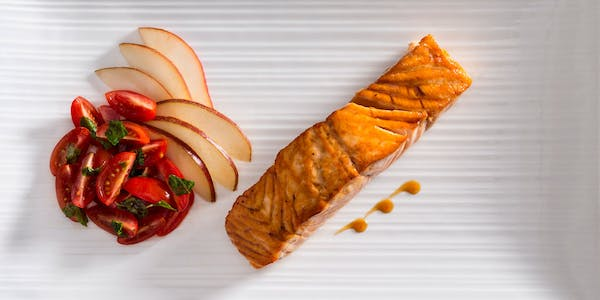 Plated Salmon with tomato basil salad and gourmet style apples