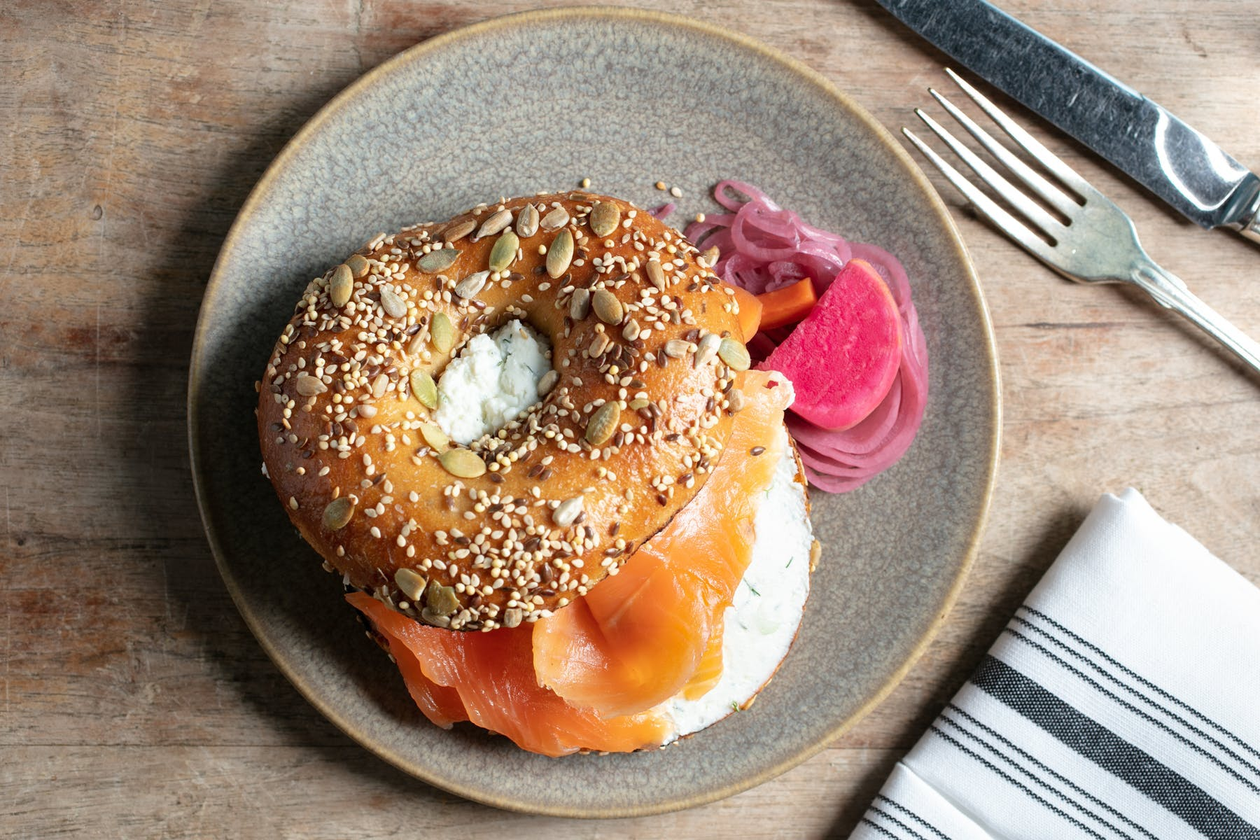 a BAGEL sitting on top of a wooden table