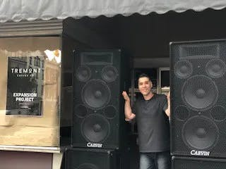 a person standing in front of a speaker