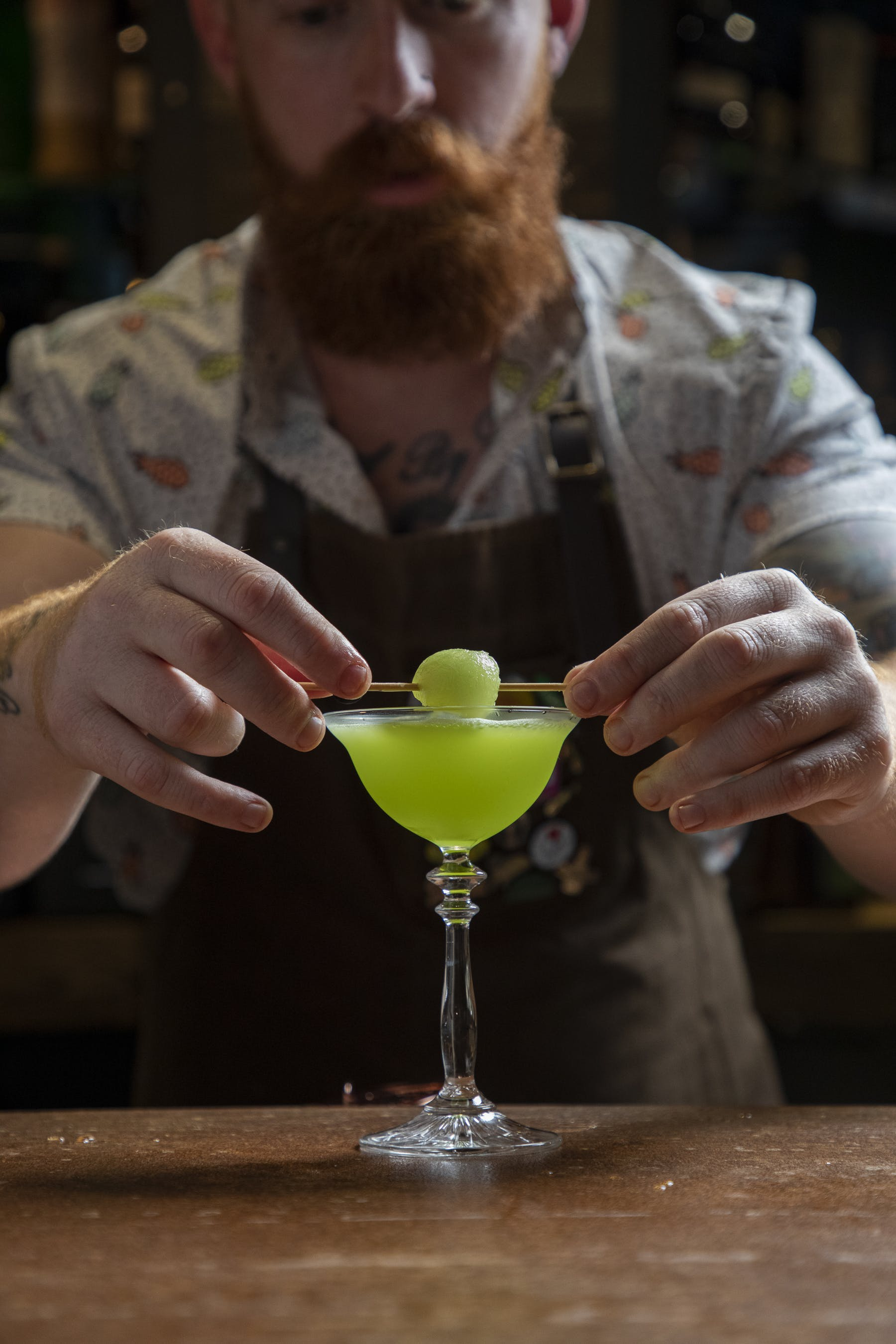 a man preparing a cocktail drink