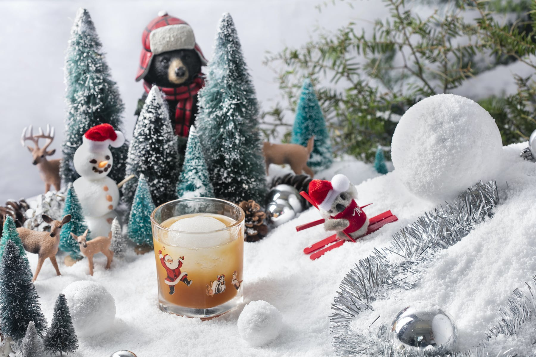 a group of stuffed animals that are in the snow