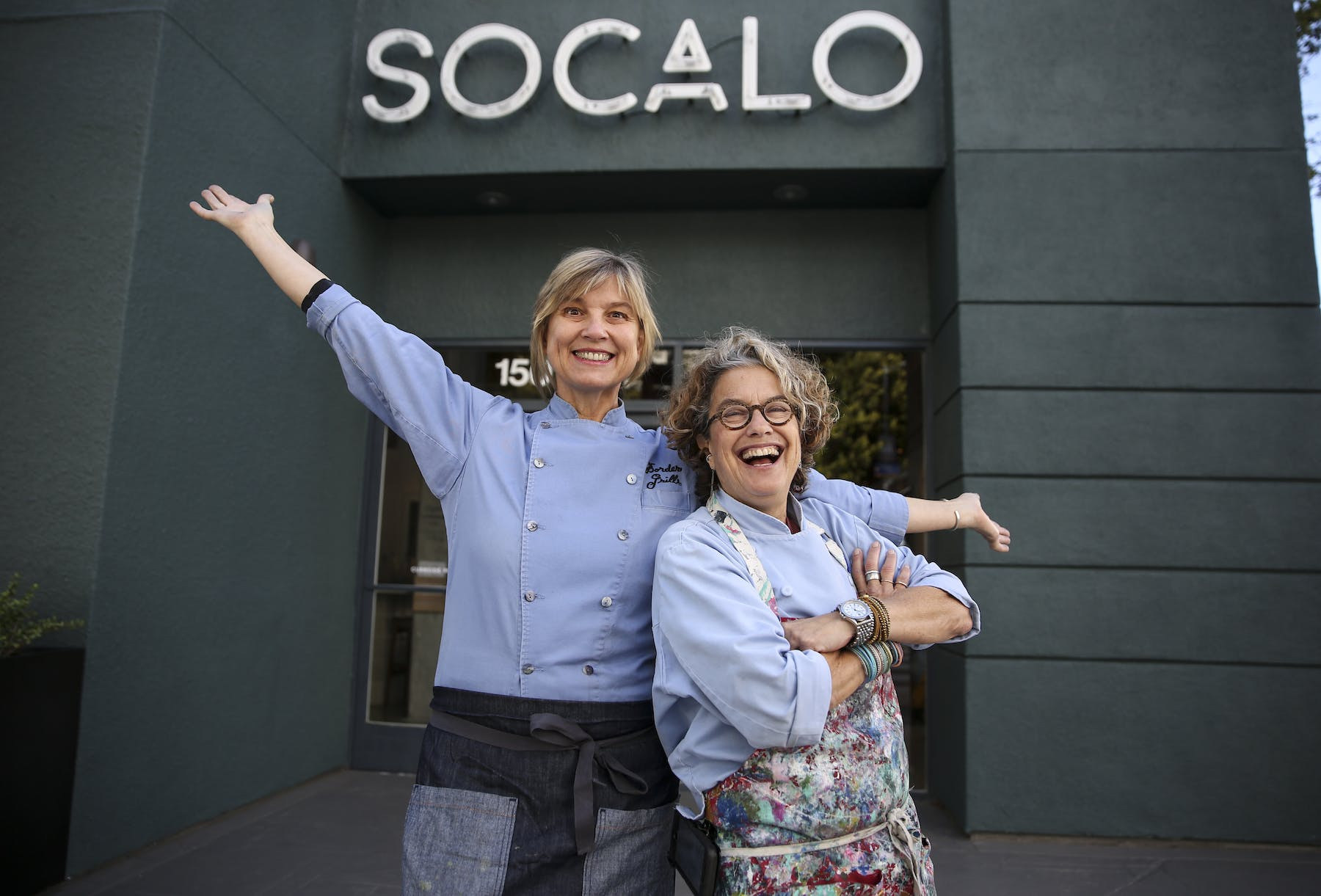 Mary Sue Milliken, Susan Feniger standing in front of Socalo restaurant