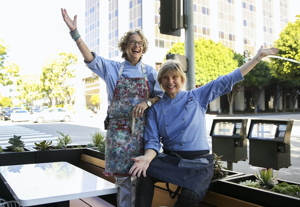 Susan Feniger, Mary Sue Milliken are posing for a picture