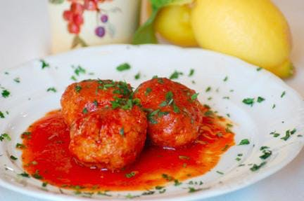 a plate topped with meatballs