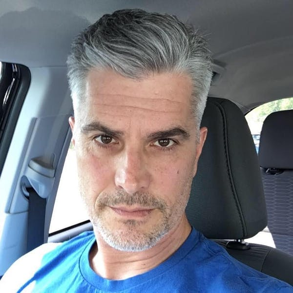 Rick Hearst sitting in a car