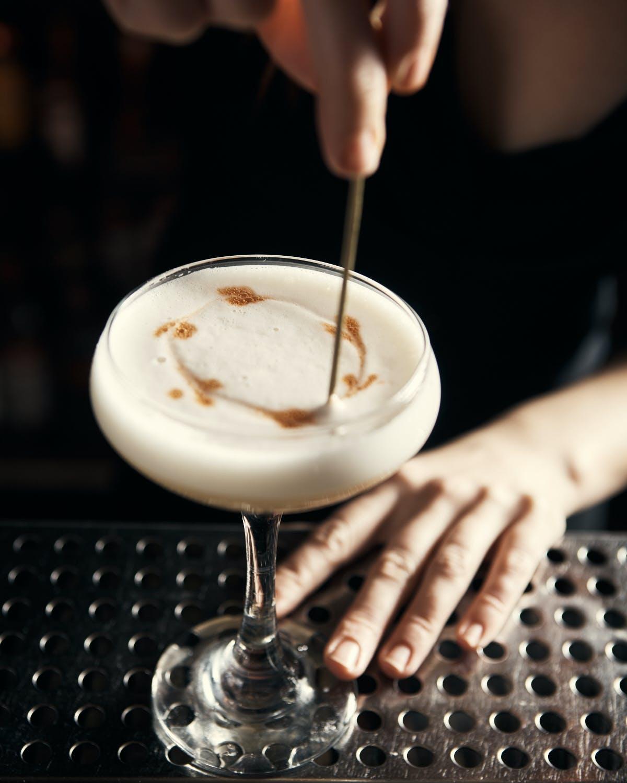 a person preparing a drink