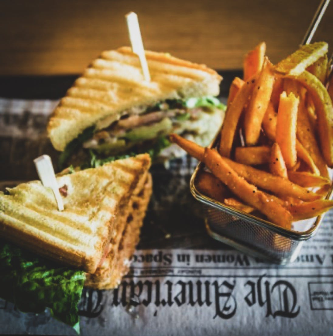 a sandwich and fries on a plate