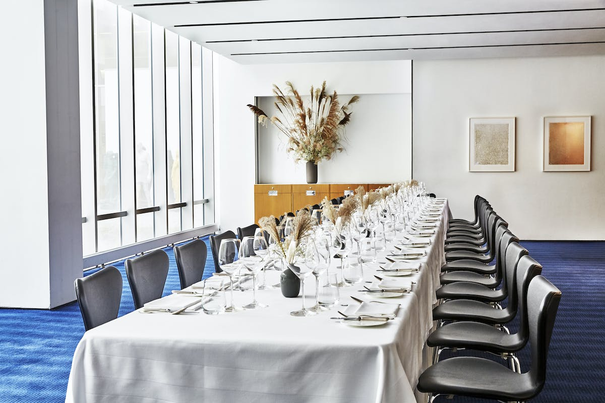 An airy, light-filled view of a large table for 26 guests in The Modern's private dining room.