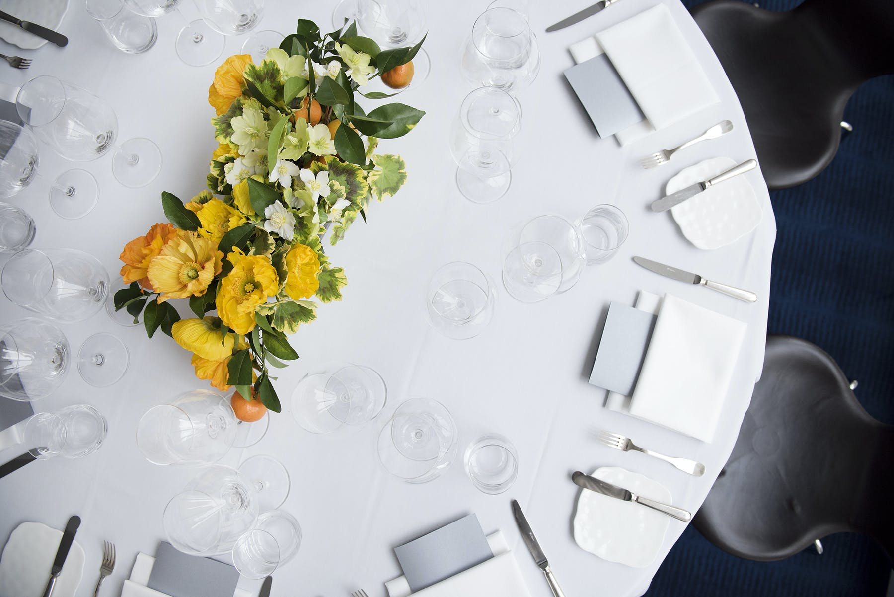 yellow flowers set as a vase on an event table