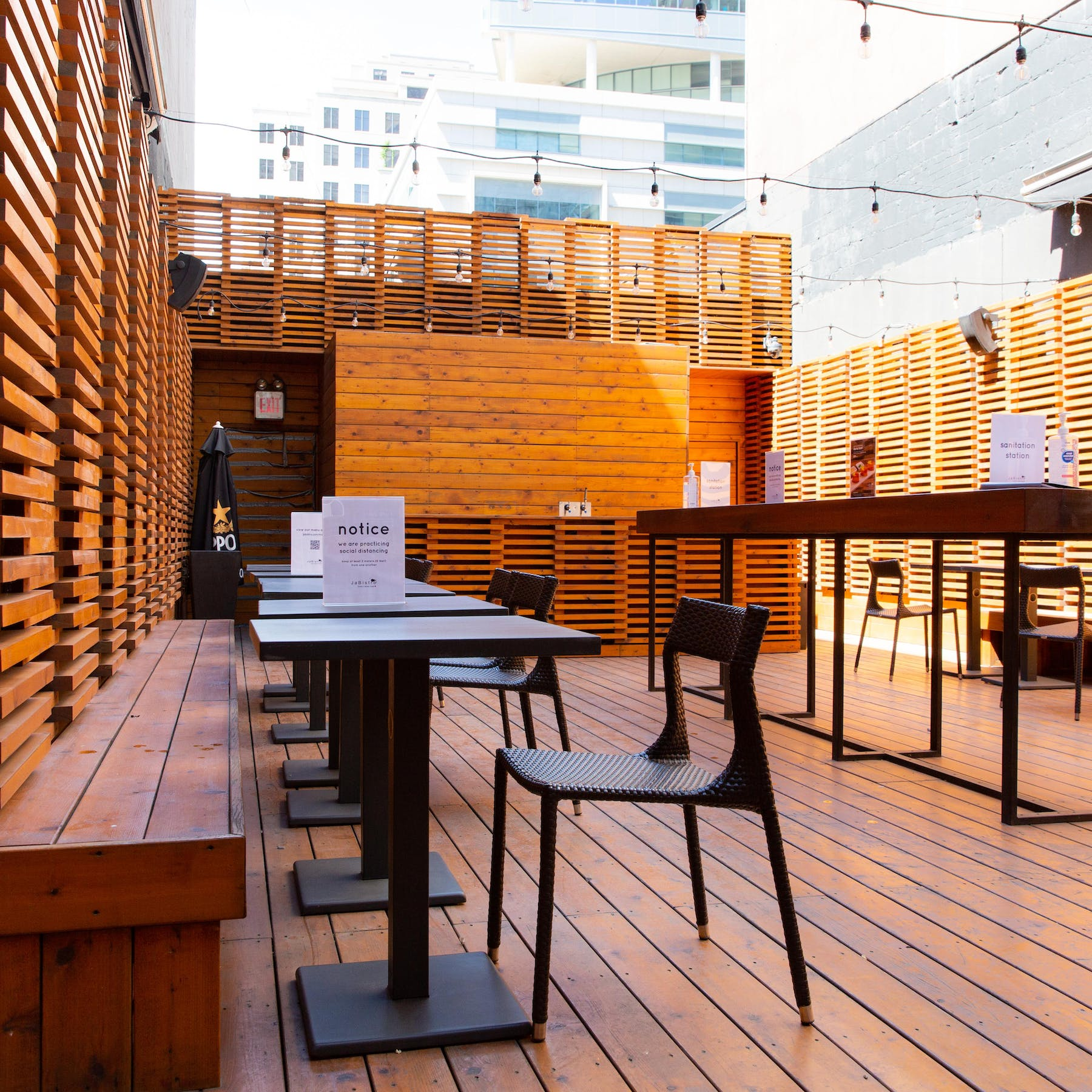 an image of a rooftop patio with seats and tables