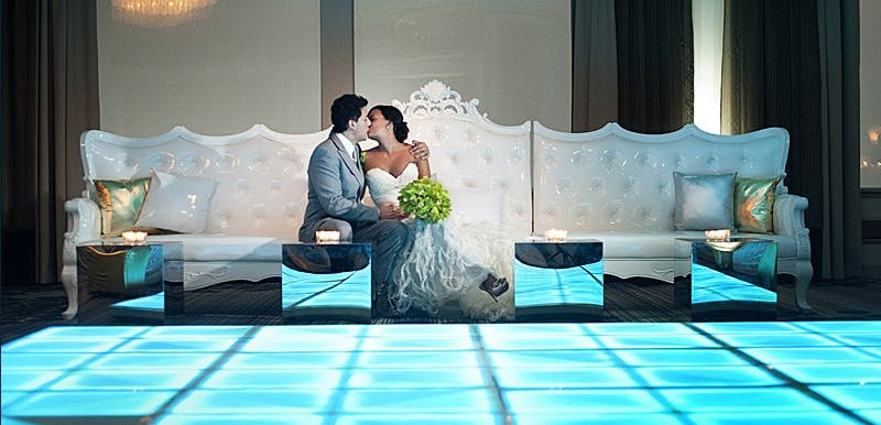 a man and a woman sitting at a Wedding