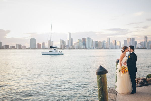 a just married couple standing in front of the miami skyline rusty pelican miami