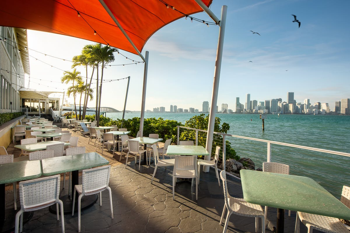 outdoor table with waterfront view of Miami
