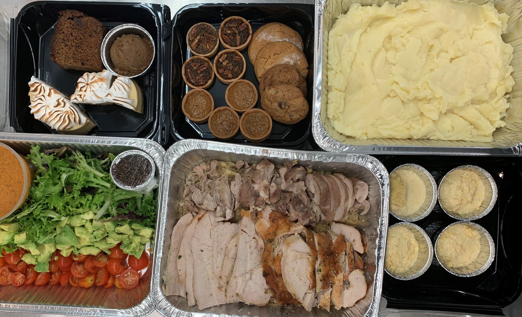 a box filled with different types of food on a tray