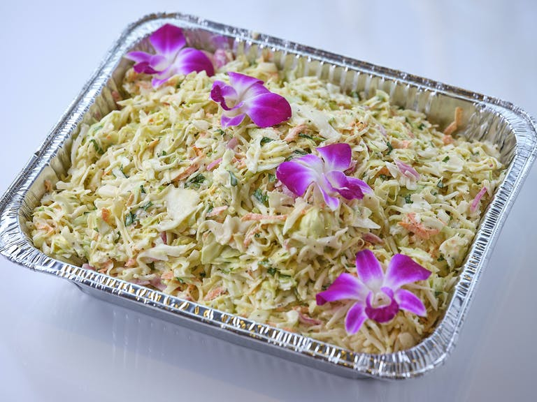 a dish is filled with purple flowers