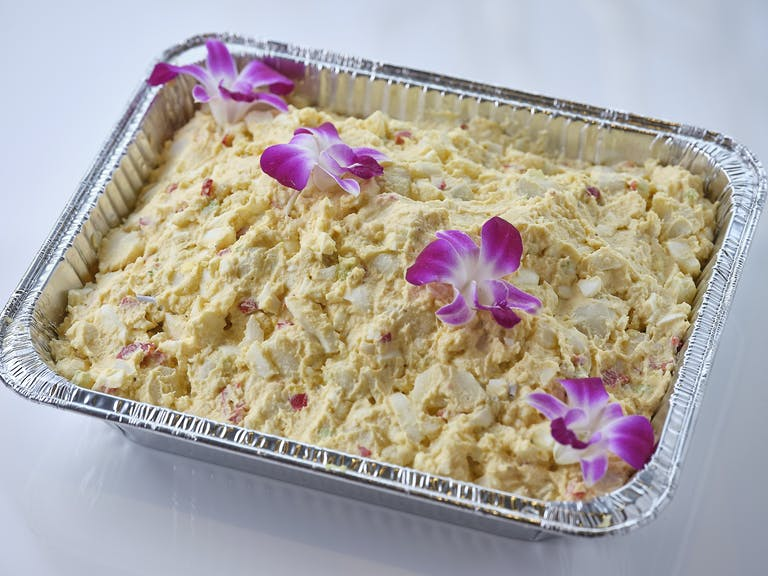 a tray filled with purple flowers
