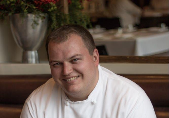 a man smiling at the camera
