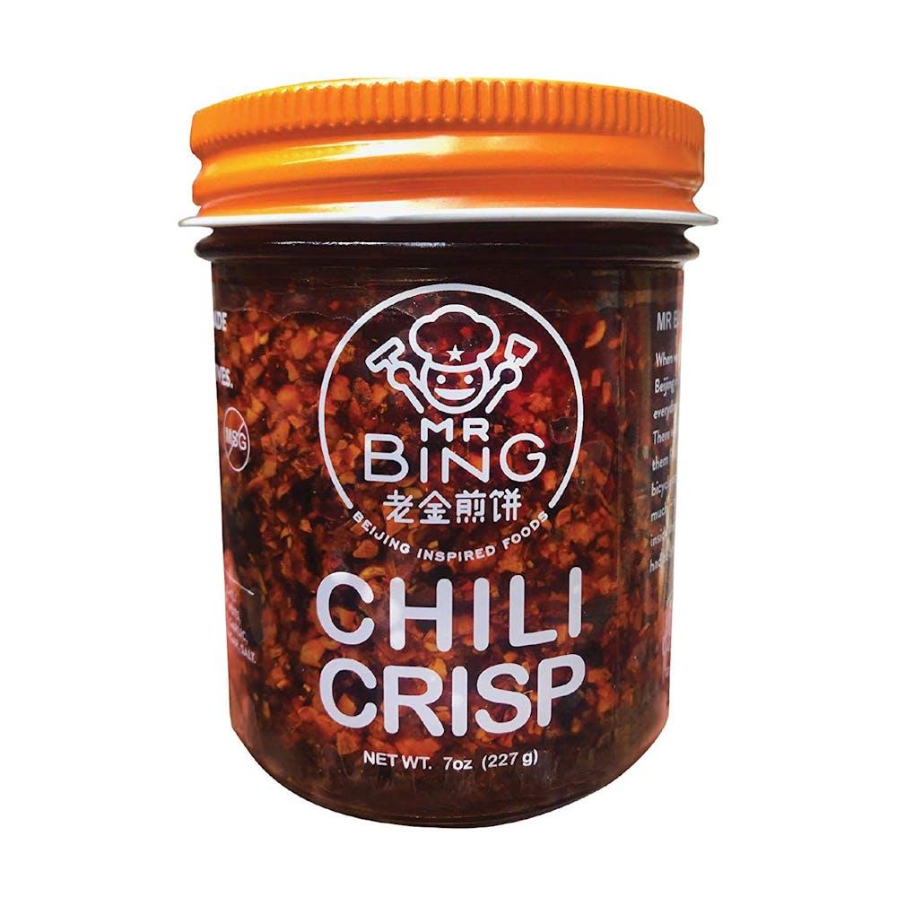 jar of mr bing chili crisp glass texture white logo orange lid stock photo