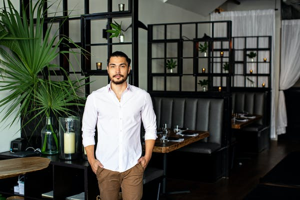 a man standing in front of a table