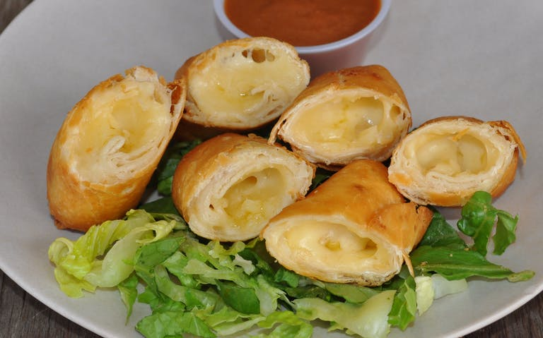 Crispy flour tortilla taquitos filled with cheese