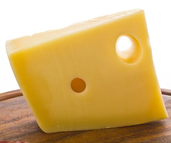 a black and yellow cheese