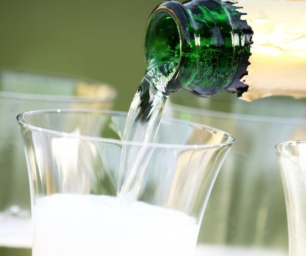 a close up of a beverage in a glass cup on a table